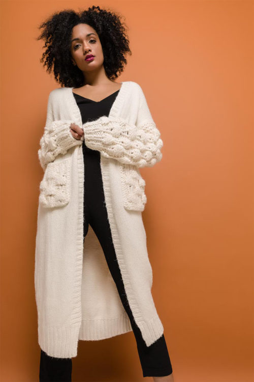 Beige long knitted cardigan model front standing
